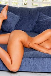 Jillisa Lynn Psoing On A Couch