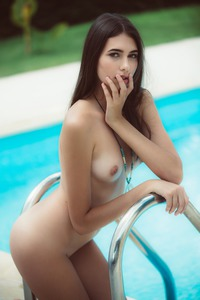 Playboy Star Katrine Pirs Near Poolside