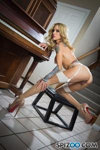 Tattoed Babe Sarah Jessie Posing Near Piano