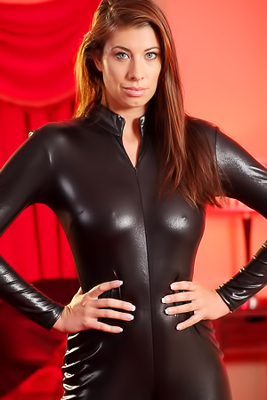 Maria pulls down leather catsuit