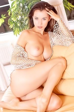 Babes orgasm on one sofa.