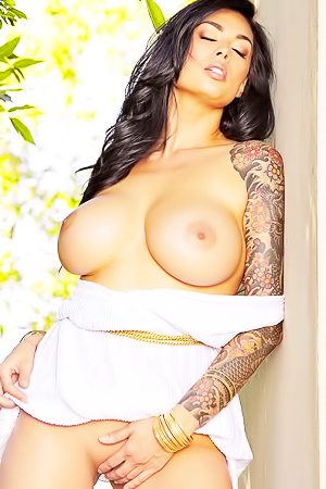 Tera Patrick strips outside in her white dress