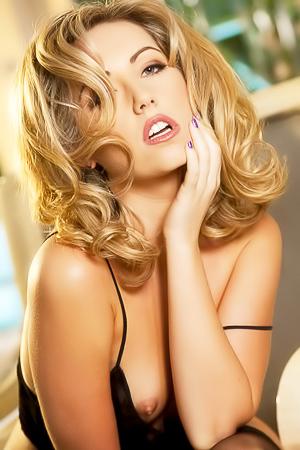 Glam blonde in stockings.