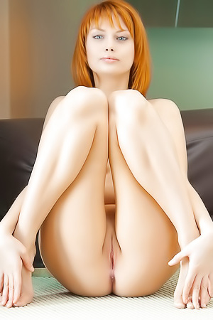 Redhead Vixen Angela D Showing Her Tiny Pink Pussy