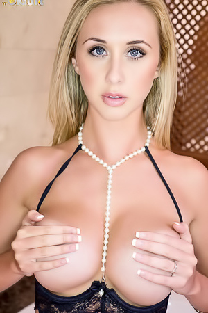 Abbey B Reveals Her Round Tits